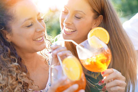 Portrait of girlfriends having fun at summer party