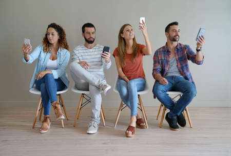 Young people with smartphones looking for connection