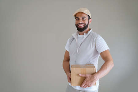 Smiling delivery man, isolated