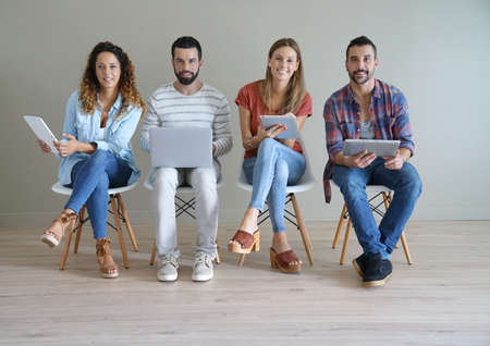 Young people connected on internet in waiting room