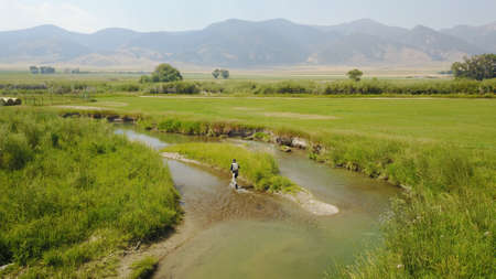 Aerial view of fly fisherman fishing in Montana river