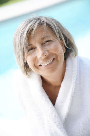Portrait of mature woman relaxing by the pool
