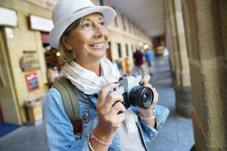 Senior woman taking pictures on tourist journey