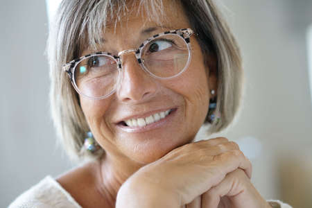 Portrait of senior woman with eyeglasses on Lizenzfreie Bilder