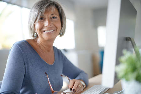 Portrait of mature woman working in office