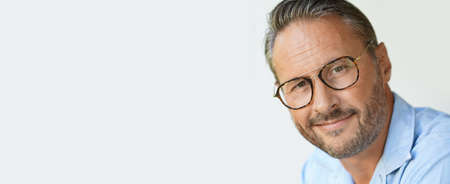 Portrait of mature man with eyeglasses and blue shirt, template Фото со стока