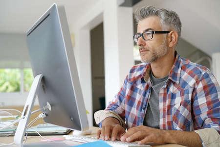 Startup businessman working in office on desktop computer