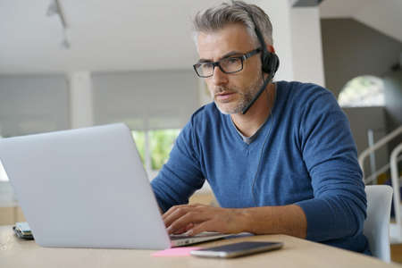 Sales representative teleworking from home-office Reklamní fotografie - 89006044