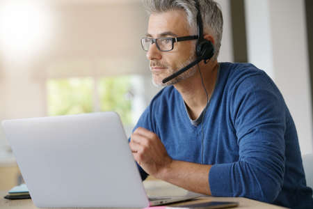 Sales representative teleworking from home-office