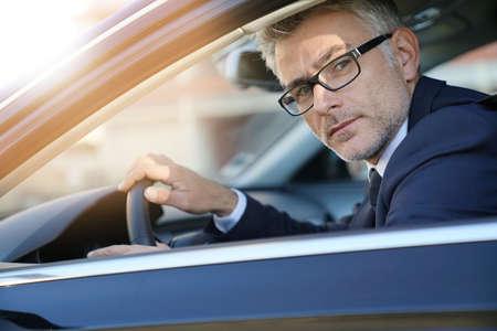 Portrait of businessman driving car for work Archivio Fotografico