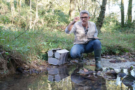 Biologist testing water quality of river Stok Fotoğraf - 90173510