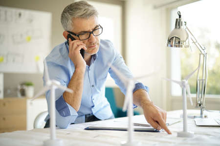 Industrial architect talking to client on phone  Stock Photo