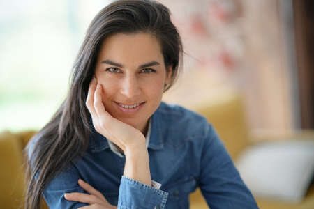 Portrait of middle-aged woman looking at camera Stock Photo