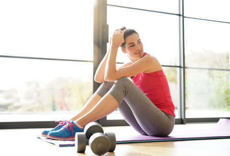 Woman doing fitness exercises at home Standard-Bild