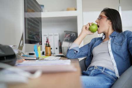 Office worker taking a break in front of desktop