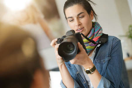 Portrait of woman photographer on a shooting day