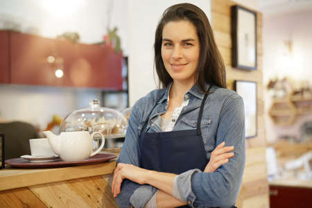 Portrait of smiling waitress in coffee shop
