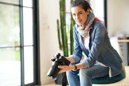 Photographer checking photo shots on camera screen Standard-Bild