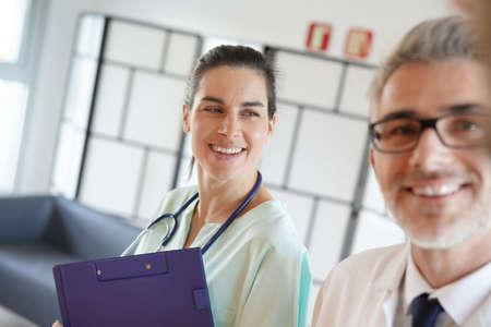Medical people walking in hospital corridor