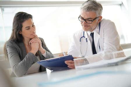 Patient meeting doctor for medical prescription