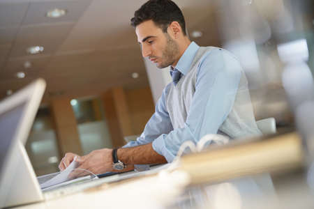 Portrait of young businessman working in office