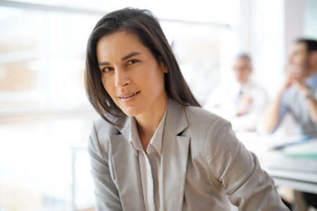 Portrait of businesswoman with grey suit