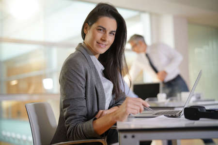Businesswoman working in office on laptop computer