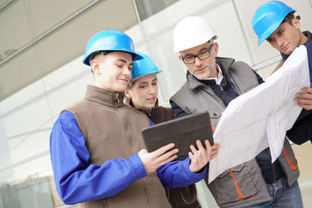 Construction manager giving instructions to training students Stock Photo