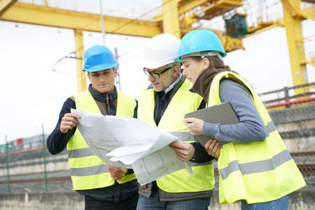 Construction site manager with young people in training period Reklamní fotografie