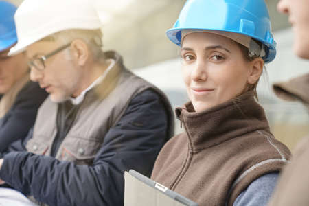 Portrait of young woman in construction industry training