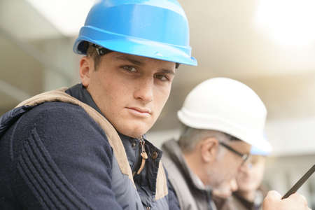 Portrait of young man in construction industry training Reklamní fotografie