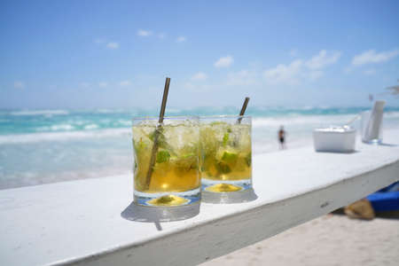 Mojito drinks set by a beach bar in Mexico