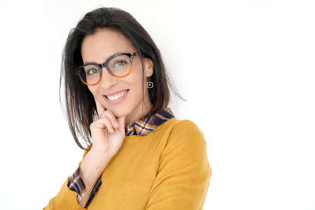 Cheerful brunette woman with eyeglasses and yellow shirt, isolated