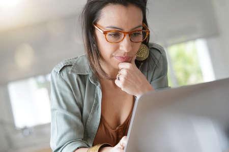 Attractive brunette woman working on laptop computer