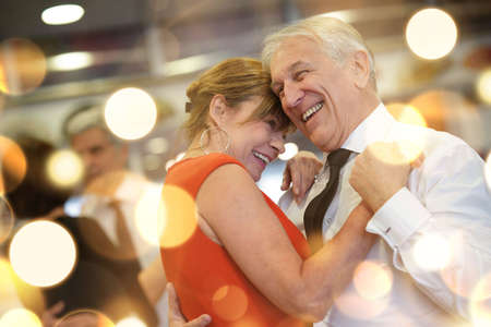 Romantic senior couple dancing together at dance hall Stockfoto