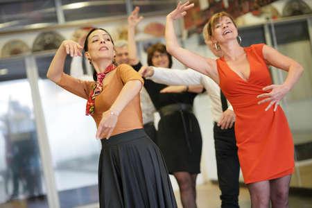 Group of senior people in dancing class with dance teacher Reklamní fotografie - 98122269