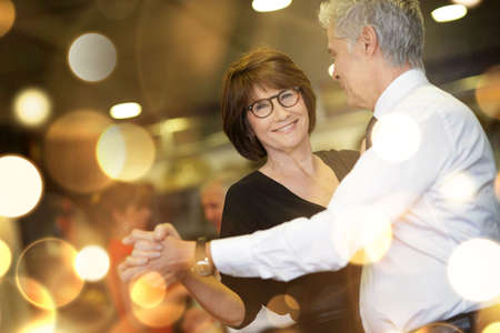 Romantic senior couple dancing together at dance hall Stockfoto