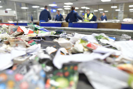 View of papers being selected in recycling factory