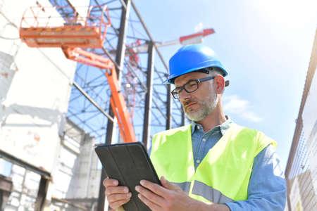 Construction supervisor inspecting building site Фото со стока