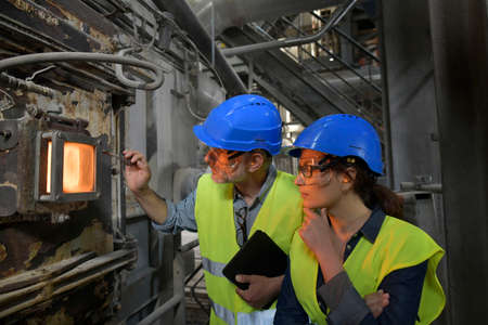 Industrial engineers working in recycling plant Reklamní fotografie