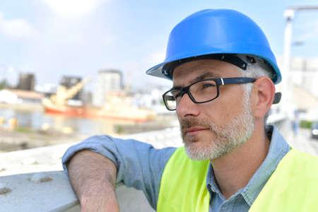 Portrait of construction supervisor standing on building site