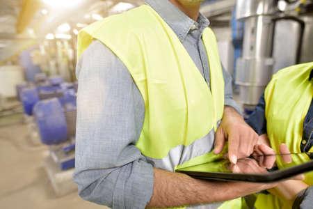 Closeup of man using tablet on industrial site Reklamní fotografie