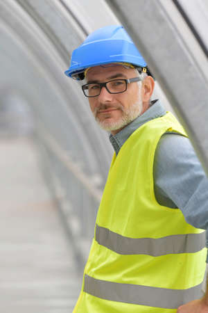 Portrait of industrial engineer with security hat and lifevest