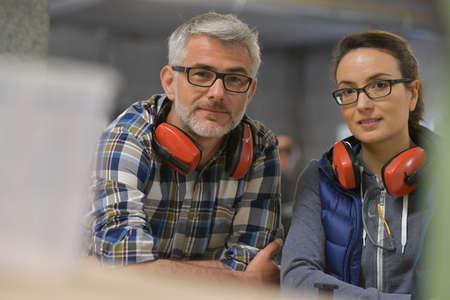 Portrait of industrial technicians in wood factory Reklamní fotografie