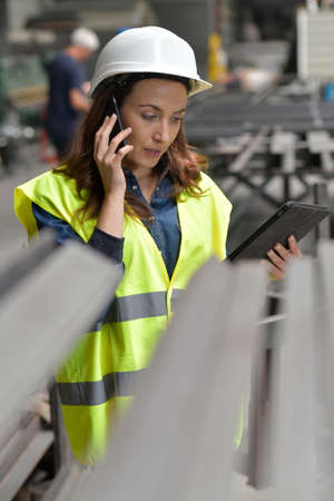 Metal industry engineer controlling work in factory