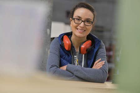 Portrait of woman working in wood industry