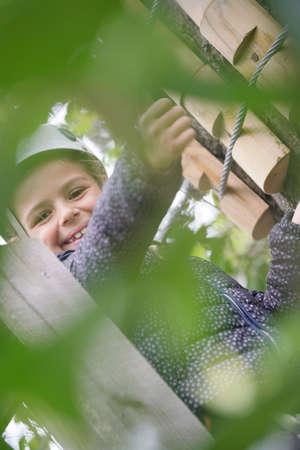 Portrait of smiling girl at tree climbing course Reklamní fotografie