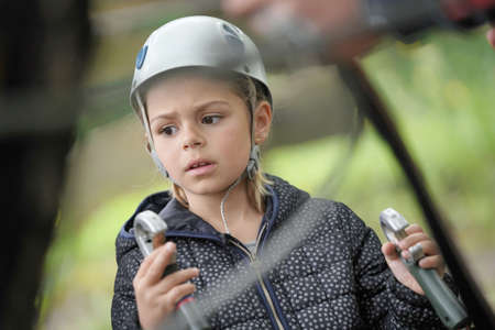 Little girl listening to safety instructions at rope park