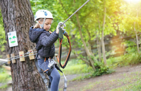 Little girl tree trekking at rope park Reklamní fotografie - 101086237