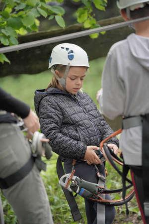Little girl listening to safety instructions at rope park Reklamní fotografie - 101087431